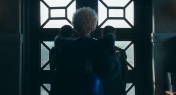 Catching Fire Teaser Trailer Screenshot 2 Effie Katniss Peeta Backview